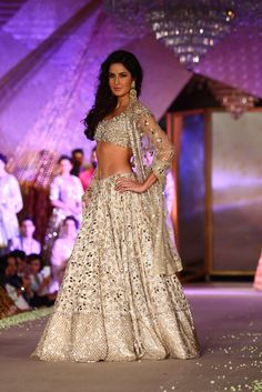 Seen on the runway after a gap, Katrina Kaif looked ravishing in an off-white lehenga decorared #heavily with #mirror with a matching #shimmering #choli.