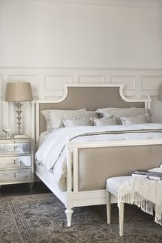 Serene, French sophistication.  Board and batten + mirrored tables + bed.