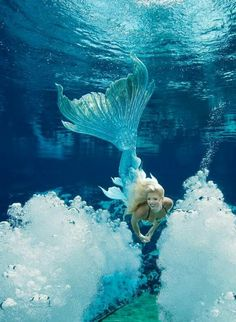A Weeki Wachee mermaid wearing a gorgeous Merbella Studios silicone tail for the 2017 mermaid calendar. This tail went on to be sold to The house of Flynn - who is a mermaid tail collector.