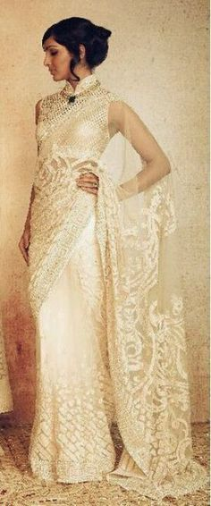 A breathtaking Tarun Tahiliani bridal sari! Love everything about the lace pallu, the intricate high neck blouse and the sheer elegance of the look - Indian wedding inspiration - Indian bride - white wedding saree - white wedding lehenga #thecrimsonbride