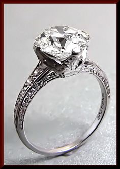 $28,000.00 Staggeringly beautiful this art deco engagement ring is set in platinum and contains an Old European cut diamonds that weighs approx. 3.25 ct