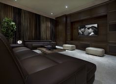 This generous viewing room Bogarts the moviegoing experience with extra-long leather sofas, blackout curtains, and a jumbo screen. At Home Movie Theater, Home Theater Rooms, Home Theater Design, Cinema Room, Highland Homes, Home Movies, Entertainment Room, Entertainment Products, Media Rooms