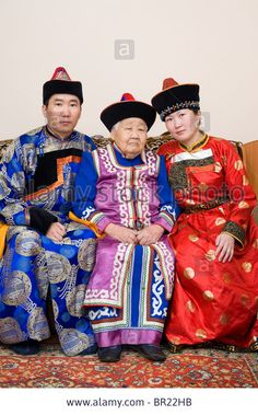 buryat (mongolian) family: grandmother, grandson and his wife, in national costumes Stock Photo