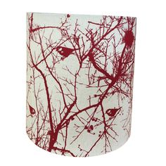 Shady Designs-Red on natural linen fabric with 4cm birds ideal for tall table lamps or slender looking floor lamps. This is a popular shape because the bottom is very slightly wider which draws your eye from the top of the shade down to your lamp base. A very modern look. Dimensions: 40cm bottom x 40cm high x 35cm top