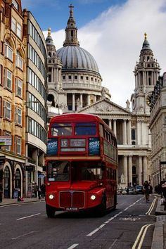 One of London's icons - the red bus, with St Paul's Cathedral in the background