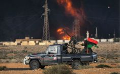 Libyan rebels attack government troops as a natural gas facility burns on the frontline on March 9, 2011, near Ras Lanuf, Libya. Nice Road Warrior Technical Vehicle
