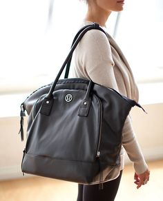 """Gorgeous and roomy Lululemon """"Seven Days of Asana"""" tote bag. Faux leather wipeable exterior, dual straps, so many interior & exterior pockets. Perfect for gym or travel! Lululemon Bags, Lululemon Clothing, Gym Bag Essentials, Lulu Love, Best Gym, Purses And Bags, Women's Bags, Gym Bags, Athletic Wear"""