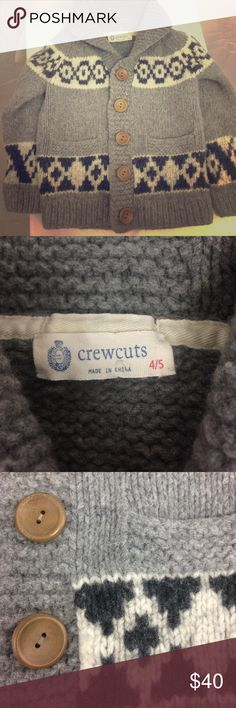 """J. Crew crewcuts Gray Wool Shawl-Collar Cardigan This adorable sweater has been gently preloved, but is still in good condition!  There is some balling of the fabric, but there is nothing major wrong with it.  It's a crewcuts boys size 4/5.  It is a nice thick sweater that has a cute design & 5 big wooden buttons.  It's 80% lambs wool & 20% nylon.  The sleeves measure about 17"""", & from the back of the collar to the bottom hem measures about 17"""" as well.  Reasonable official offers may be…"""