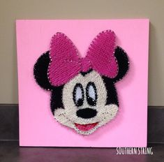 Minnie Mouse string art.  Perfect for your little girls room or a Mouse themed birthday party! Oh Toodles!