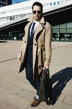 Shop this look for $294:  http://lookastic.com/men/looks/overcoat-and-tie-and-dress-shirt-and-messenger-bag-and-derby-shoes-and-jeans-and-blazer/826  — Camel Overcoat  — Navy Tie  — White Dress Shirt  — Olive Messenger Bag  — Brown Derby Shoes  — Navy Jeans  — Navy Blazer