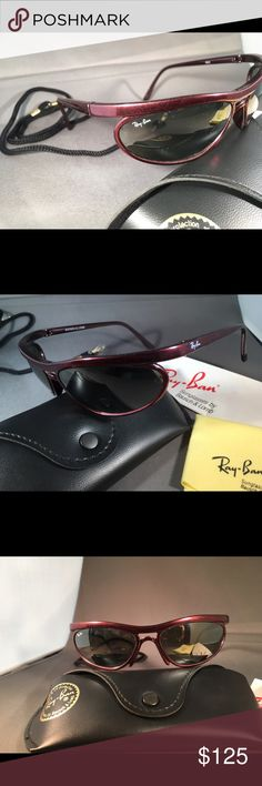 Vintage Ray Ban Sunglasses by Bausch & Lomb VINTAGE RAY BAN SUNGLASSES by BAUSCH & LOMB from the 90's   Predator Style V (5) Crimson Rage W2493   New Old Stock Never Worn  Crimson color plastic frame140mm  G-15 Silver Mirror Lenses 100% UV Protection  Original Case,Cleaning Cloth and Neck Strap Included as pictured Ray-Ban Accessories Sunglasses