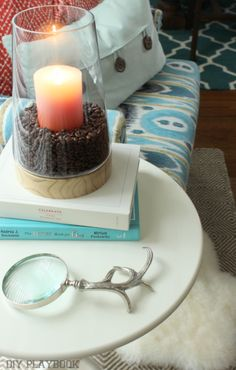 Use coffee beans in a vase with a candle to fill your home with delicious aromas.