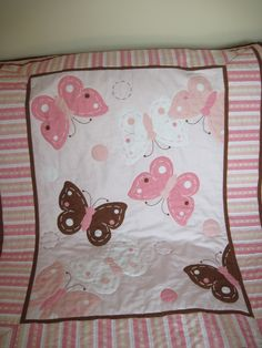 Butterfly Baby Quilt/Wallhanging -- Pink, Brown and White Butterflies. $39.50, via Etsy.