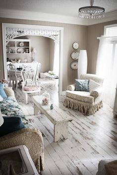 Love the gingerbread trim in the doorway    (...cr....love the bench coffee table.....would be able to build)