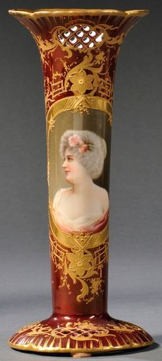 """Royal Rudolstadt Porcelain Hand Painted Vase, Germany, 1901-1925, pierced rim and foot, raised gold flowers and foliage to a dark ruby ground with central oval cartouche enamel decorated with a portrait of a woman, title below the vase """"Vezzella"""""""