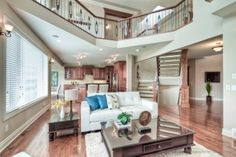 Grand great room with open to above and wrought iron railings. Iron Railings, Estate Homes, Wrought Iron, Great Rooms, The Hamptons