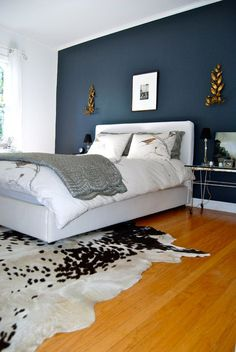 Beautiful bedroom with some a gorgeous cowhide adding warmth and texture