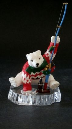 A must have for any Coke A Cola collector. A wonderful Polar Bear Ice fishing for bottles of Coke.