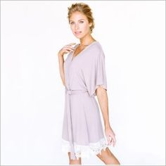<p>This delicate whisper-soft robe is crafted with an easy, fluid and drape-y fit. It features finespun lace, dolman sleeves and a tie at the waist. The sash is detachable and excludes belt loops to allow for various looks and styling including a loose, low slung belt or cinched tightly as the waist. It's a pretty piece for lounging and getting ready.</p> <ul> <li>95% rayon, 5% spandex</li> <li>Sizing runs slightly small and short</li&...