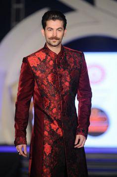 Neil Nitin Mukesh in burgundy red floral sherwani by Rohit Verma. More photos… Indian Men Fashion, Indian Bridal Fashion, Men's Fashion, Fashion Show, Fashion Outfits, Indian Groom Wear, Indian Wear, Indian Wedding Clothes For Men, Wedding Sherwani