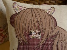 Highland Cow raw edge applique free motion machine embroidery cushion.  Vintage tweeds and wool fabrics on linen.  A commission by Julie Filmer from The Peacock Emporium