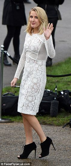 Looking all white! The pop princess looked lovely in her white lace pencil dress, which she teamed with black suede peep-toe shoe boots for her stylish day out