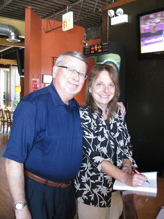 Jennie & Rocco Spallone smile as Jennie signs one of her mystery books Book Signing, Mystery Books, Simple Way, Book Art, Crime, Novels, Sun, Mystery Novels, Crime Comics