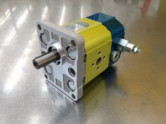 This is a new motor version available. It has both valve, anti-cavitation and relief valve at the same time to protect the motor against exceeding pressure and inertial problems (like the motor that keeps rotating after it is stopped).