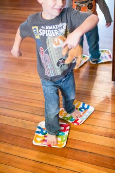 Paper Plate Skating Simple Gross Motor Activity - awesome for balancing!