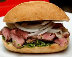 A delicious sandwich of grilled steak, garlicky chimichurri sauce, and sweet onion relish (salsa criolla).