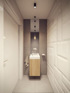 The bathroom is not so spacious, but the clean design means there is plenty of room for all the necessary preparations for the day. A concrete basin and clean tile shower are ultramodern while the dangling Edison light gives the room just a little bit more personality.