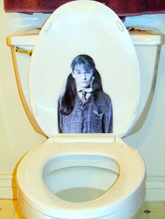 Moaning Myrtle makes an appearance on the toilet lid for a Harry Potter party