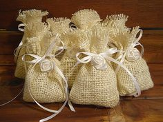 Set of 10 Wedding Rice Favor Bags handmade of bleached burlap, white satin ribbon and embellished with a handmade white satin rose, $15.00