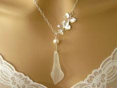 Calla Lily Necklace $42.00, via Etsy.  Very pretty..^_^