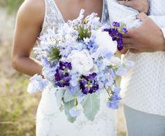 6.   Soiree Floral:  Bouquet of blue agapanthus, blue hydrangea, Charlie Brown peonies, lavender sweetpea, purple stock, dusty miller, lavender.