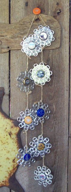 Diy Bottle Cap Crafts 852376666955878653 - ideas garden art ideas wind chimes bottle caps Source by reinemesbahigmailcom Can Tab Crafts, Soda Can Crafts, Aluminum Can Crafts, Aluminum Cans, Metal Crafts, Recycled Crafts, Diy Crafts, Pop Top Crafts, Bottle Top Crafts