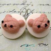 Vaaleanpunavalkoiset nallekorvikset 12€