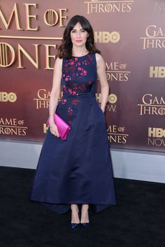 Instead of making a statement with a flaming head of hair à la Melisandre, she lets her voluminous navy frock with hot pink embroidery do the work.   - MarieClaire.com