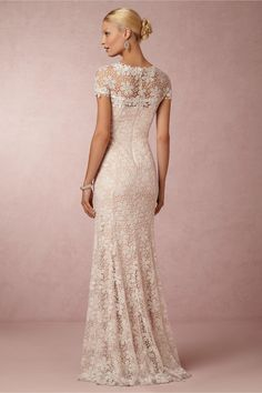 Nova Lace Gown in Bride Wedding Dresses at BHLDN   $1,000.00 4.8 / 5 (6) STYLE: 34317685  With roots in the modern art movement of 1960s Japan, designer Tadashi Shoji is passionate about designing his own luxurious fabrics and achieving an impeccably tailored fit. Covered from sheer neckline to hem in the most intricate ivory, petal-strewn lace, this slim gown mixes a vintage glamour with a clean-lined, contemporary cut.  A BHLDN exclusive From Tadashi Shoji Back zip Polyester; polyester…