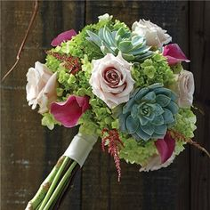 Beautifully hand-crafted with a colorful blend of ivory roses, green mini hydrangeas, dark pink mini calla lilies, fresh-cut succulents and pink astilbe, this gorgeous mixed bouquet will instantly transport any bride to a charming far-off vineyard. Wedding Flower Guide, Flower Bouquet Wedding, Lily Bouquet, Flower Bouquets, Wedding Ideas, Bride Bouquets, Bridesmaid Bouquet, Bridesmaids, Ivory Roses