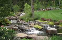 Water Features & Waterscaping - Gallery | Alderwood Landscaping Coeur d' Alene, Idaho Private Residence Cascading Water Feature Spans One Area of Yard-Under Driveway and Continues Below