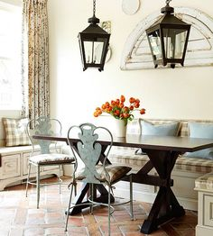 Banquette and painted chairs