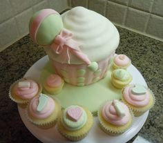 Baby Shower Cupcakes! Lemon cupcakes iced with pink lemon cream cheese frosting, vanilla bean cupcakes iced with green vanilla bean...