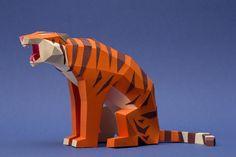 Геометрически сложенные из бумаги 3D-животные