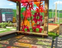 outdoor classroom with colorful windows