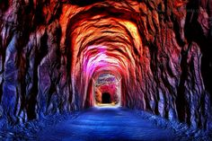 railroad tunnel lit like a rainbow