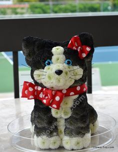 This cat is made from fresh flowers. It is handcrafted by our floral designers. It is a perfect gift for cat-lovers or someone who appreciates unique and beautiful things.
