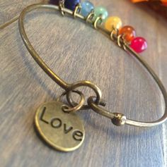 If you desire more love in your life, or wish to see more love in the lives of those around you, all you need do is focus upon the energy of love. Love symbols assist us in focusing upon this energy. Bracelet Gift Box, Bangle Bracelets With Charms, Healing Bracelets, Gemstone Bracelets, Bracelets For Men, Bracelet Making, Gemstone Beads, Bangles, Chakra Symbols