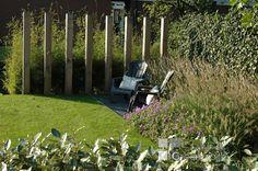 Tuin in Reeuwijk met palenwand als afscheiding