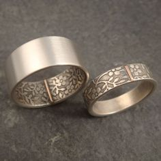 This is the second pattern Ive used for my Opposites Attract wedding band design. It features a forget me not pattern that is suggestive of: